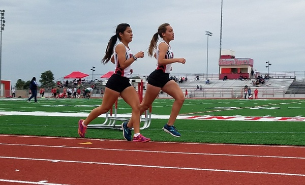 Emiliana Merida and Genesis Obispo, members of Elsinore's Varsity team, during the 2 mile race.